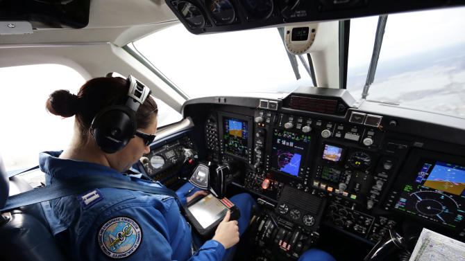 Pilot Lt. Rebecca Waddington checks the GPS during a National Oceanic and Atmospheric Administration flight to document coastal changes after Superstorm Sandy, Thursday, Nov. 1, 2012. (AP Photo/Alex Brandon)