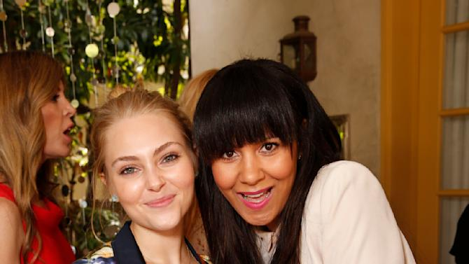 AnnaSophia Robb and Taye Hansberry attend the Polish Play and emPower Chrome Girl Nail Lacquer Debut on Saturday, April 27, 2013 in Los Angeles.(Photo by Todd Williamson/Invision for Chrome Girl/AP)