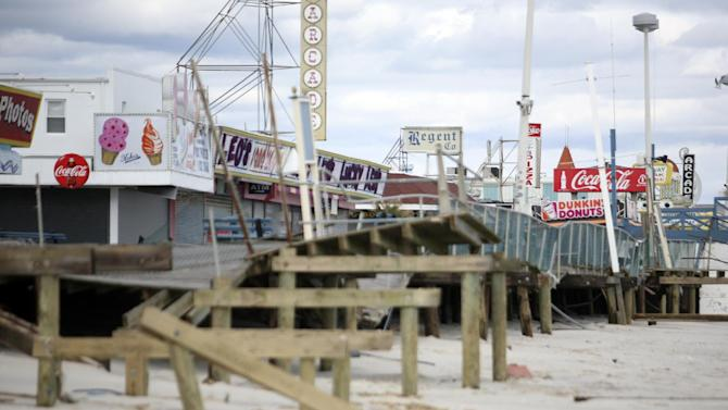 FILE - In this Oct. 31, 2012 file photo, the Seaside Heights boardwalk is heavily damaged after Superstorm Sandy moved through the area. The iconic boardwalk where generations of families and teens got their first taste of the Jersey Shore and where the reality show of the same name was filmed is being rebuilt following its destruction in Superstorm Sandy. Seaside Heights on Wednesday, Jan. 16, 2013 awarded a $3.6 million contract to have the boardwalk rebuilt in time for Memorial Day weekend. (AP Photo/The Star-Ledger, David Gard, Pool, File)
