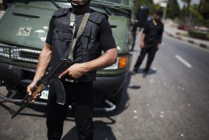 Egyptian police special forces stand guard beside an…