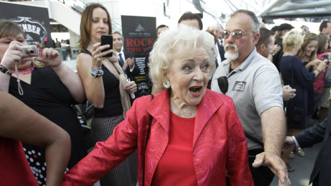 """Actress Betty White, from the cast of """"Hot in Cleveland"""", arrives at the Rock and Roll Hall of Fame and Museum in Cleveland for a V.I.P. party and tour Wednesday, June 15, 2011. (AP Photo/Mark Duncan)"""
