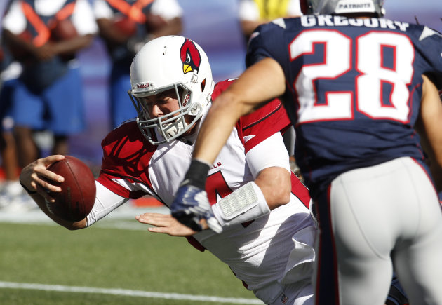1Arizona Cardinals quarterback Kevin Kolb (4) scores a touchdown in front of New England Patriots safety Steve Gregory (28) in the third quarter of an NFL football game on Sunday, Sept. 16, 2012 in Foxborough, Mass. The Cardinals won 20-18. (AP Photo/Stephan Savoia)