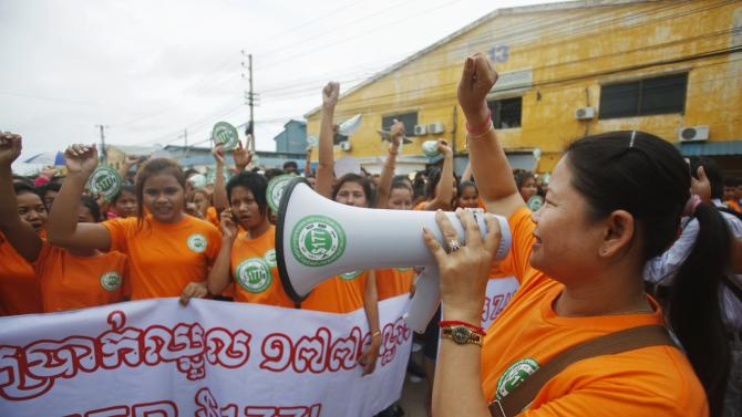 Garment workers shout during a protest calling for higher wages in Phnom Penh