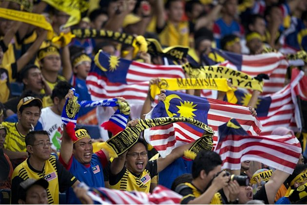 Co-hosts Malaysia recovered from an opening 3-0 loss against Singapore to beat Laos 4-1 and Indonesia 2-0