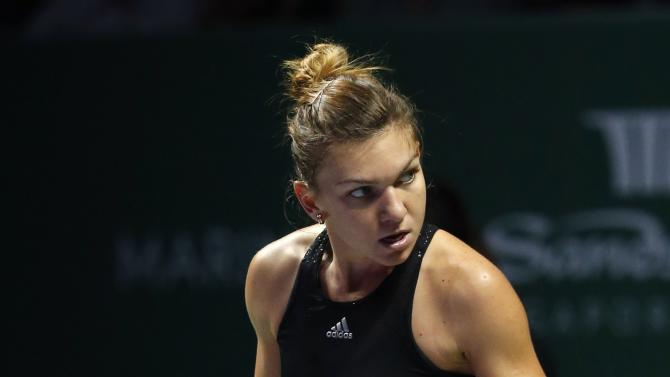 Simona Halep of Romania celebrates a point against Serena Williams of the U.S. during their WTA Finals singles tennis match at the Singapore Indoor Stadium