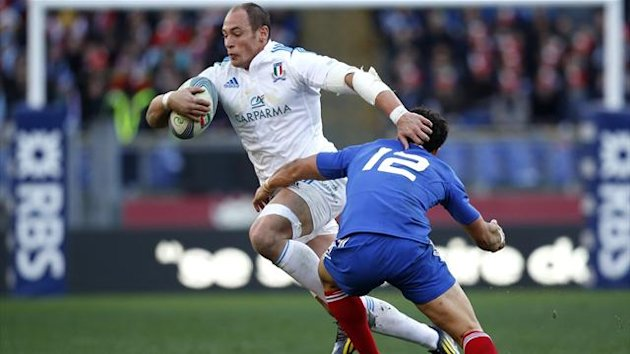 2013Italy's Sergio Parisse (L) is tackled by Maxime Mermoz of France during their Six Nations international Rugby Union match at the Olympic stadium in Rome February 3, 2013