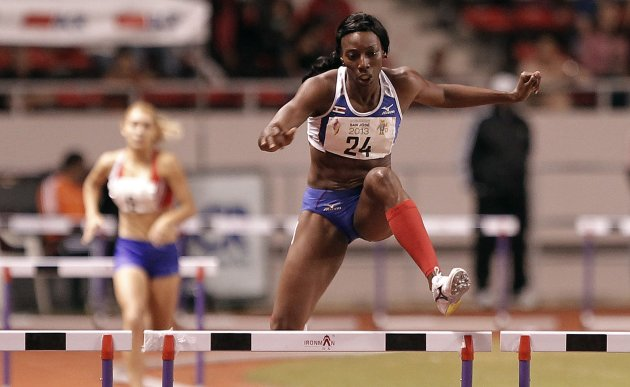 Costa Rica's Scott jumps the last hurdle in the women's 400m hurdles final at the Central American Games in San Jose