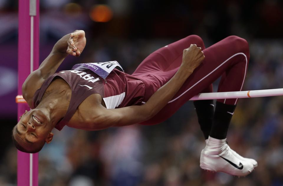 Qatar's Mutaz Essa Barshim clears the bar in the men's high jump final during the athletics in the Olympic Stadium at the 2012 Summer Olympics, London, Tuesday, Aug. 7, 2012. (AP Photo/David J. Phillip)