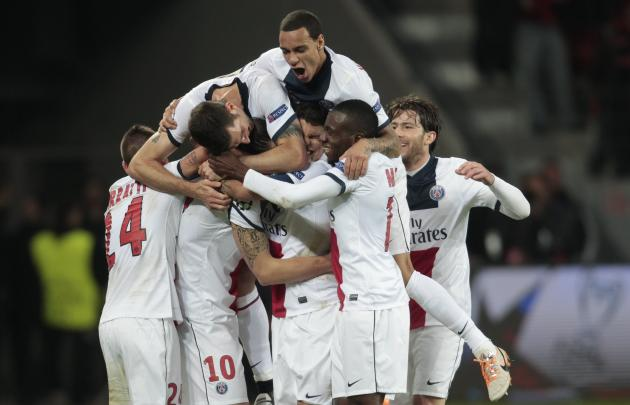 Paris St. Germain's players celebrate a goal against Bayer Leverkusen during their Champions League soccer match in Leverkusen
