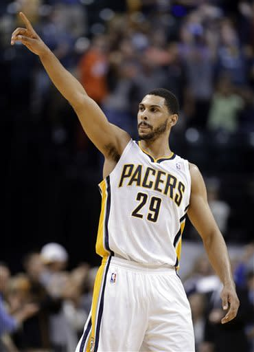Indiana Pacers forward Jeff Pendergraph salutes the fans following the Pacers' 99-94 win over Cleveland Cavaliers in an NBA basketball game in Indianapolis, Tuesday, April 9, 2013