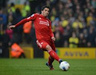 Liverpool's Uruguayan striker Luis Suarez on the ball in a Premier League match against Norwich City at Carrow Road in April. Liverpool can look forward to a Battle of Britain showdown against Scottish club Hearts in the play-off round of the Europa League after the draw was made