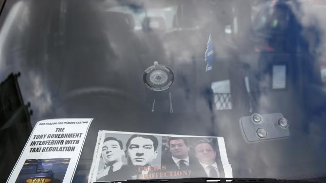 Flyers are displayed in a London cab dduring a protest by London cab drivers against Uber in central London
