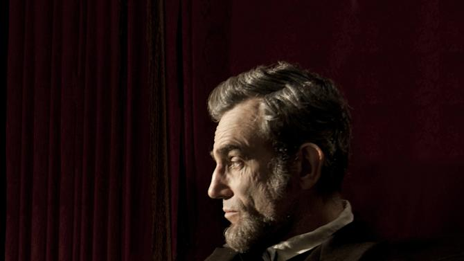 "CORRECTED CAPTION: FILE - This publicity film image released by DreamWorks and Twentieth Century Fox shows Daniel Day-Lewis portraying Abraham Lincoln in the film ""Lincoln.""  The Producers Guild of America announced the motion picture and long-form television nominations for the 24th Annual Producers Awards on Wednesday, Jan. 2, 2013, in Los Angeles. The Darryl F. Zanuck Award for Outstanding Producer of Theatrical Motion Pictures included these nominees, ""Argo,"" (Warner Bros.) producers: Ben Affleck, George Clooney, and Grant Heslov; ""Beasts of Southern Wild,"" (Fox Searchlight Pictures) producers: Michael Gottwald, Dan Janvey, and Josh Penn; ""Lincoln,"" (Touchstone Pictures) producers: Kathleen Kennedy and Steven Spielberg; among other film producers and productions. (AP Photo/DreamWorks, Twentieth Century Fox, David James, File)"