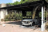The wreckage of a car sits inside the US embassy compound in Benghazi. The US has boosted security at its embassies amid fears that more anti-American violence sparked by a film mocking Islam could erupt after Friday's Muslim prayers across the Middle East and North Africa