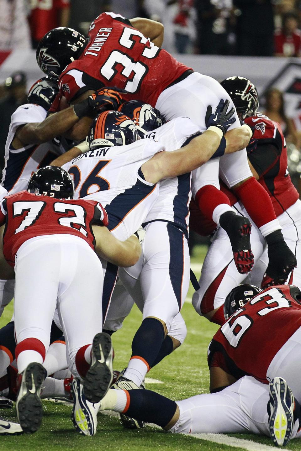 Atlanta Falcons running back Michael Turner (33) dives for a touchdown against the Denver Broncos during the first quarter of an NFL football game, Monday, Sept. 17, 2012, in Atlanta. (AP Photo/John Bazemore)
