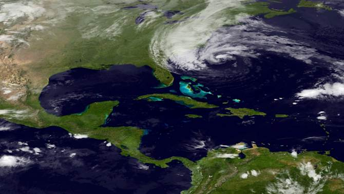 In this image taken by NOAA's GOES East on Sunday, Oct. 28, 2012, Hurricane Sandy is seen on the East Coast of the United States.  Sandy weakened briefly to a tropical storm Saturday but was soon back up to Category 1 strength, packing 75 mph winds. It was about 260 miles (420 kilometers) south-southeast of Cape Hatteras, N.C., and moving northeast at 13 mph as of 5 a.m. Sunday, according to the National Hurricane Center in Miami. The storm was expected to continue moving parallel to the Southeast coast most of the day and approach the coast of the mid-Atlantic states by Monday night, before reaching southern New England later in the week. (AP Photo/NOAA)
