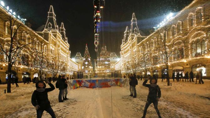 A woman reacts after a heavy snowfall in central Moscow