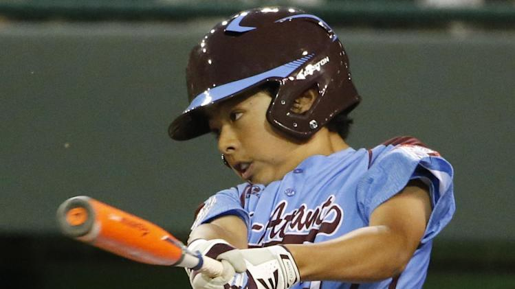 Philadelphia's Jack Rice drives in two runs with a single off Chicago's Marquis Jackson in the first inning of an elimination baseball game at the Little League World Series tournament in South Williamsport, Pa., Thursday, Aug. 21, 2014. (AP Photo/Gene J. Puskar)