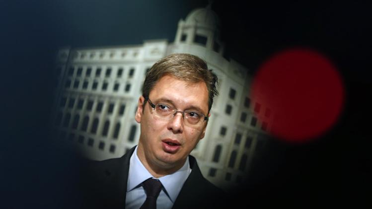 """Serbian Prime Minister Aleksandar Vucic speaks during a government press conference in Belgrade, Serbia, Friday, Aug. 22, 2014. Vucic says the Balkan country will not impose sanctions against Russia or curb its food exports despite pressure from the European Union. The EU has warned candidate countries to refrain from """"exploiting"""" the Russian ban by increasing their exports. (AP Photo/Darko Vojinovic)"""