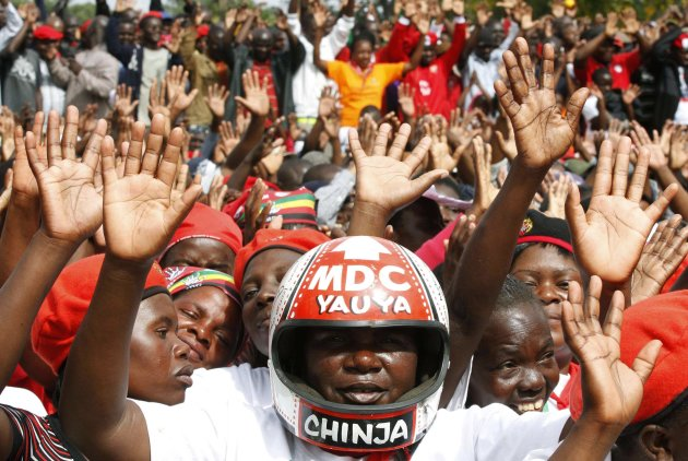 Supporters of Zimbabwe's opposition party Movement For Democratic Change cheer at a rally in Harare