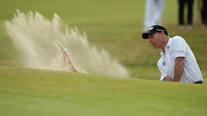 US golfer Jim Furyk plays from a green-side bunker on the 18th hole during his fourth round 65, on the final day of the 2014 British Open Golf Championship at Royal Liverpool Golf Course in Hoylake, north west England on July 20, 2014