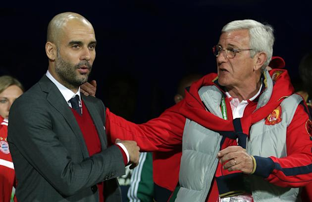 Bayern head coach Pep Guardiola of Spain, left, and Guangzhou Evergrande's coach Marcello Lippi of Italy arrive for their semifinal soccer match between Guangzhou Evergrande FC and FC Bayern Munic