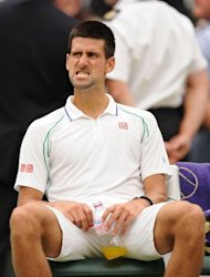 Serbia's Novak Djokovic ponders after losing the first set of his third round men's singles match against Czech Republic's Radek Stepanek. He came back to win 4-6, 6-2, 6-2, 6-2