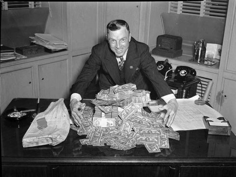 man with a pile of money