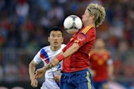Spain's Fernando Torres (R) controls the ball next to South Korea's Choi Hyo-Jin during their international friendly football match at the Stade de Suisse stadium, in Bern. Spain thumped South Korea 4-1