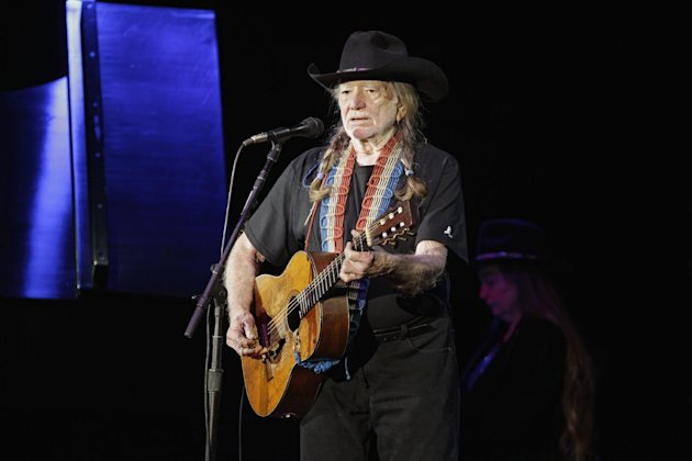 In a Jan. 29, 2012 photo country music icon Willie Nelson performs during a fund raising concert for U.S. Rep. Dennis Kucinich in Lorain, Ohio. Organizers of a Colorado fundraiser say country music legend Willie Nelson cancelled an appearance Saturday Aug. 18, 2012. (AP Photo/Mark Duncan)