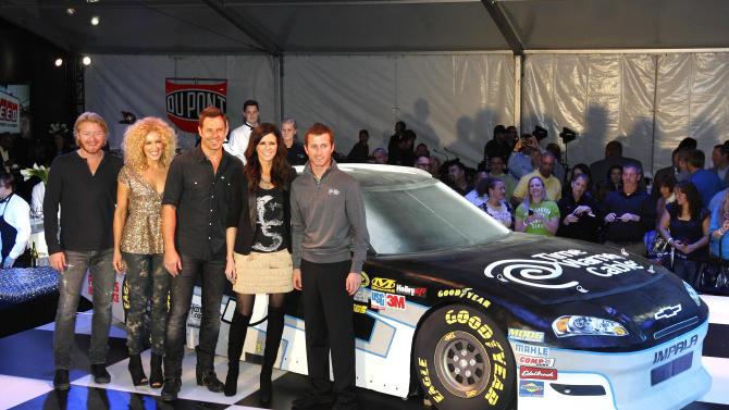 IMAGE DISTRIBUTED FOR TIME WARNER CABLE - Country music stars Little Big Town pose with Kasey Kahne in front of the cake car replica at the celebration for the unveiling of the Kasey Kahne No. 5 Time Warner Chevrolet, on Wednesday, Oct. 10, 2012 in Charlotte, N.C. (Photo by Matthew T. Thacker/Invision for Time Warner Cable/AP Images)