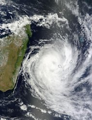 This visible image of Tropical Cyclone Dumile over La Reunion Island and Mauritius was captured by the MODIS instrument aboard NASA&#39;s Terra satellite on Jan. 3, 2013, at 0650 UTC. Dumile&#39;s center was just northwest of Reunion (left) and Mauriti