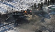 Derailed train cars burn in Plaster Rock, N.B., Jan.8, 2014. THE CANADIAN PRESS/Tom Bateman
