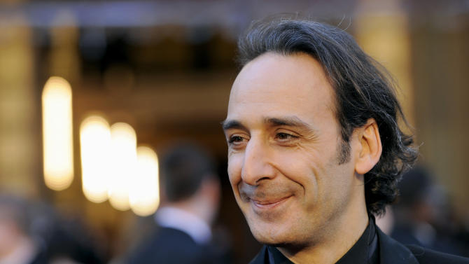 """FILE - In this Sunday, Feb. 27, 2011 file photo, composer Alexandre Desplat arrives before the 83rd Academy Awards, in the Hollywood section of Los Angeles. For the first time, a composer will lead the international jury at the Venice Film Festival. Organizers said Monday, June 23, 2014 that the jury president this year will be Frenchman Alexandre Desplat, a six-time Oscar nominee and Golden Globe winner. His many credits include the scores for """"Godzilla,"""" """"The King's Speech,"""" ''Argo"""" and """"Philomena."""" Desplat began his career in French cinema and broke into Hollywood in 2003 after composing for """"Girl with a Pearl Earring."""" (AP Photo/Chris Pizzello, File)"""