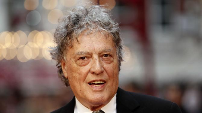 """FILE - This Sept. 4, 2012 file photo shows British playwright Tom Stoppard at the world premiere of """"Anna Karenina"""" in London. Stoppard's latest project is a five-part miniseries, """"Parade's End,"""" premiering Tuesday, Feb. 26, on HBO. (AP Photo/Sang Tan, file)"""