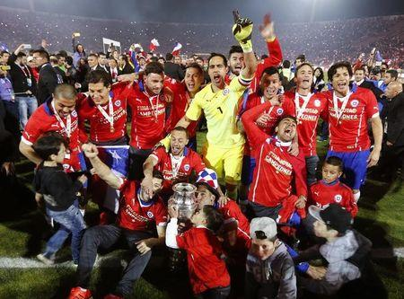 Chile celebrates with the trophy after defeating Argentina to win the Copa America 2015 final soccer match at the National Stadium in Santiago