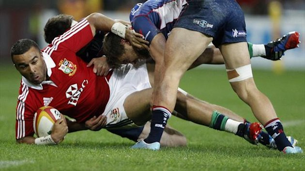 British and Irish Lions' Simon Zebo (L) is tackled by Melbourne Rebels' Mitch Inman and Lachlan Mitchell (R) during their rugby game in Melbourne June 25, 2013 (Reuters)