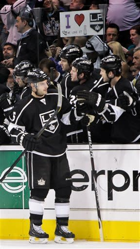 Kings beat Canucks 4-1 to open homestand