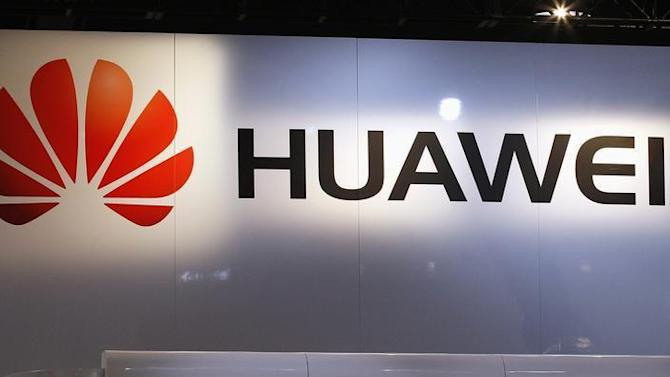 The logo for Chinese phone maker Huawei hangs above their booth on the first day of the Consumer Electronics Show in Las Vegas