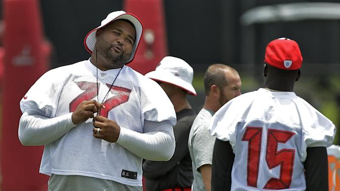 Tampa Bay Buccaneers injured guard Carl Nicks (77) talks to side receiver Lavelle Hawkins during an NFL football minicamp Thursday, June 12, 2014, in Tampa, Fla