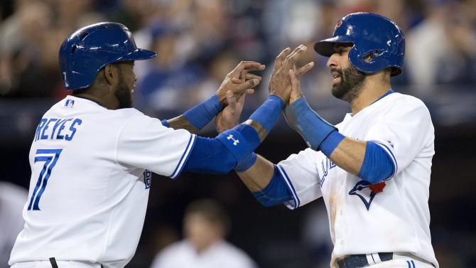 Bautista homers, Jays rout Mariners 14-4