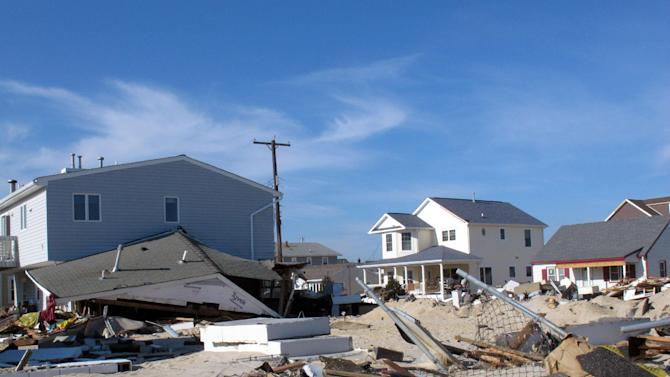 This Nov. 29, 2012 photo shows a devastated oceanfront neighborhood in the Ortley Beach section of Toms River N.J. Residents told a state Senate panel on Monday, Oct. 21, 2013 that insurance woes and bureaucracy are doing as much damage to them as the storm did as they try to recover from Superstorm Sandy a year later. (AP Photo/Wayne Parry)