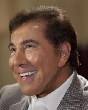 """FILE - In this April 27, 2011 file photo, Steve Wynn is interviewed in Las Vegas. Wynn and porn producer Joe Francis faced off before jurors Tuesday, Sept. 4, 2012, with the casino mogul denying that he threatened to kill the """"Girls Gone Wild"""" founder and saying the accusation is threatening his upscale casinos. (AP Photo/Julie Jacobson, File)"""