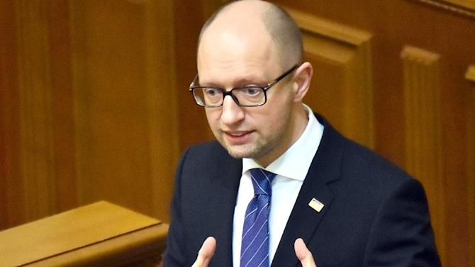 """Ukrainian Prime Minister Arseniy Yatsenyuk, pictured on December 11, 2015, admitted that the Kremlin's most recent steps against Kiev """"significantly complicated"""" Ukraine's trade"""