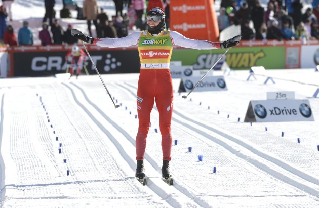 Poland's Kowalczyk celebrates winning the ladies' 10 km cross-country skiing World Cup event at the Lahti Ski Games in Lahti