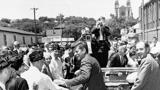 FILE - In this June 1960 file photo, U.S. Rep. George McGovern, joins Sen. John F. Kennedy on the campaign trail  in Sioux Falls, S.D. A family spokesman says, McGovern, the Democrat who lost to President Richard Nixon in 1972 in a historic landslide, has died at the age of 90. According to a spokesman,  McGovern died Sunday, Oct. 21, 2012 at a hospice in Sioux Falls, surrounded by family and friends.  (AP Photo, File)
