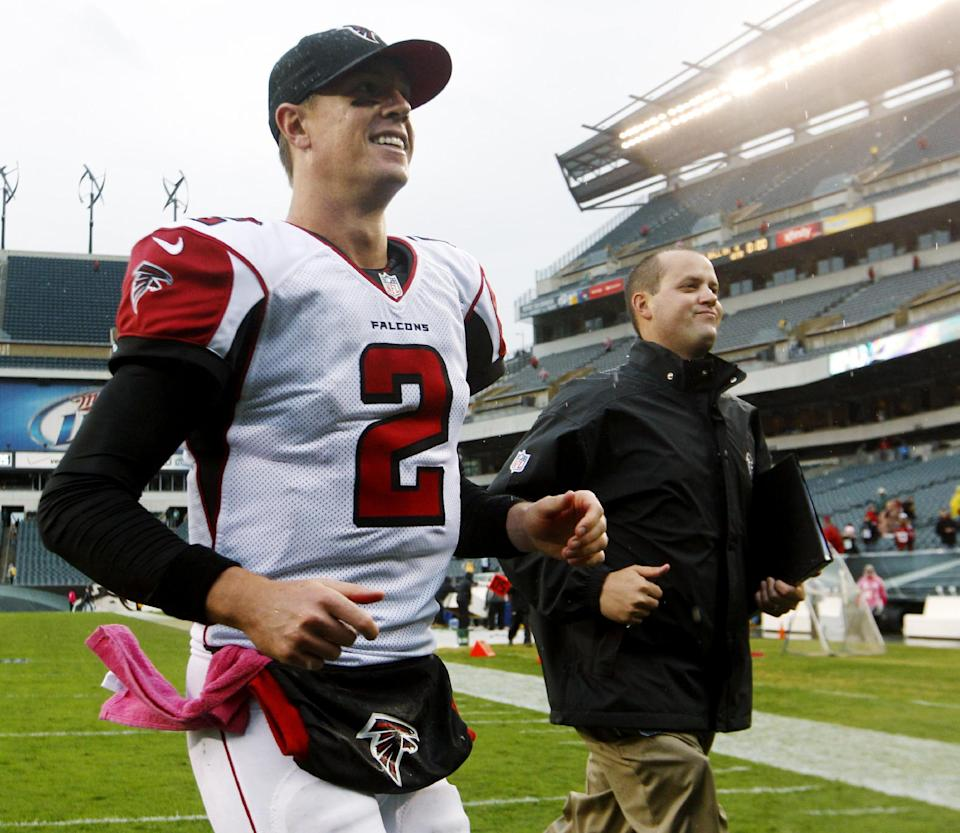 Atlanta Falcons quarterback Matt Ryan leaves the field after leading his team to a 30-17 victory over the Philadelphia Eagles in an NFL football game, Sunday, Oct. 28, 2012, in Philadelphia. (AP Photo/Mel Evans)