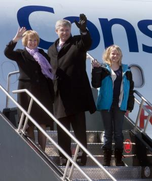 Canadian Conservative leader Stephen Harper boards his campaign plane with wife, Laureen, and daughter Rachel in Ottawa, Ontario, Saturday, March 26, 2011. Opposition parties brought down Harper's government in a no confidence vote Friday, triggering an election that polls show the Conservatives will win. Canadians go to the polls May 2. (AP Photo/The Canadian Press, Adrian Wyld)