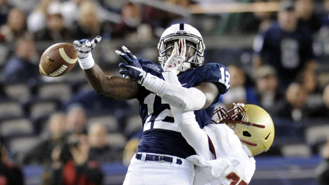 Boston College defensive back Kamrin Moore, left, breaks up a pass intended for Penn State wide receiver Chris Godwin during the first half of the Pinstripe Bowl NCAA college football game Saturday, Dec. 27, 2014, in New York. (AP Photo/Bill Kostroun)