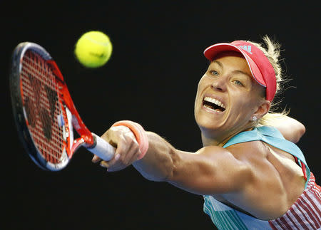 Germany's Kerber stretches for a shot during her final match against Williams of the U.S. at the Australian Open tennis tournament at Melbourne Park